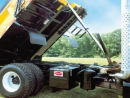 The DuraClass Sidewinder's understructure is a stacked structural steel design with channel crossmembers and I-beam long members. Front mounted inverted telescopic hoist with hard chrome plated sleeves eliminates the need for a cylinder housing inside of