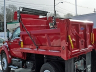 SL Dump Body shown with 1/2 cab shield, tarp rod, full height front board pockets, pull down style patch gate and driver's side step.
