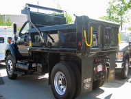 SL Dump Body shown with 1/2 cab shield, tarp rod, full height front board pockets, single handle over center lock patch gate and driver's side step.