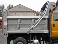 SL Stainless Steel Dump Body with 1/2 cab shield, tarp rod and walk rail.