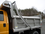 SL Stainless Steel Dump Body with 1/2 cab shield, slide-out ladder, tarp rod and walk rail.