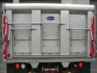 SL Stainless Steel Dump Body with 3 single handled over center lock patch gates and LED lights.