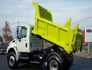 SL Dump Body shown with 1/2 cab shield, full height front and rear board pockets, single handle over center lock patch gate and slide out driver's side ladder.