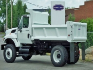 SL Dump Body shown with 1/2 cab shield and slide out driver's side ladder.