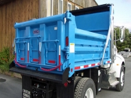 "10' SL316 Dump Body with 30"" sides and 40"" ends, shown with two way swing tailgate, three over center style sliding doors, lower grip strut walk rail and flat bar tarp rail."