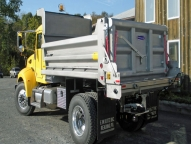 SL316 Stainless Steel Dump Body shown with slide out ladder, walk rail and pull down style sliding patch gate.