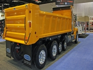 """HPT at 2012 NTEA Work Truck Show built with 8ga high-tensile steel sides, front and tailgate, 1/4"""" AR235 floor and stacked and filled understructure. This body was built to withstand punishment."""