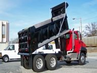 HPT Dump Body shown with 1/2 cab shield, aluminum side boards, spill apron and telescopic hoist.