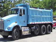 HPT Dump Body shown with 1/2 cab shield, driver's side steps, horizontal and vertical side braces and spill apron.
