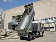 HPT-B1 Dump Body shown with 1/2 cab shield, inside steps and fold down driver's side ladder, aluminum side boards, spill apron and telescopic hoist.